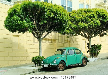 Green old Volkswagen Beetle in San Francisco, California, USA,