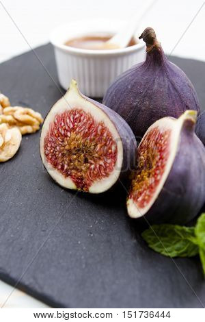 Figs honey and walnuts A group of figs with walnuts and honey