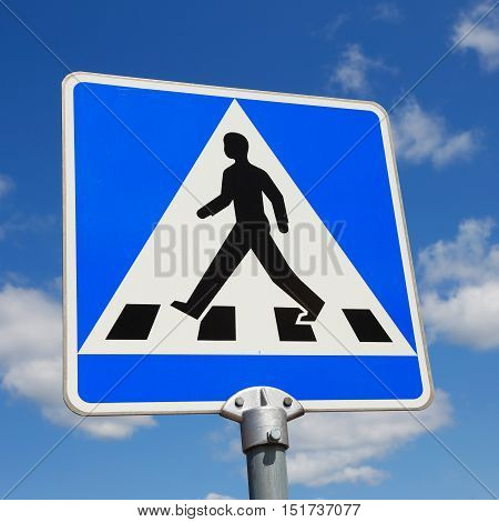 Close-up of a Swedish road sign for pedestrian crossing.