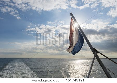 Wadden Sea with Dutch flag as seen from the ferry