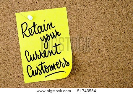 Retain Your Current Customers Text Written On Yellow Paper Note