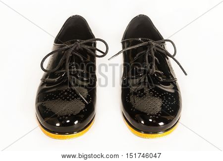 black patent leather shoes on white background