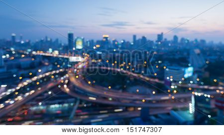 Abstract blurred lights highway interchanged with city downtown background