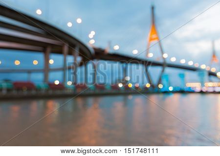 Abstract blurred bokeh lights suspension bridge over watergate