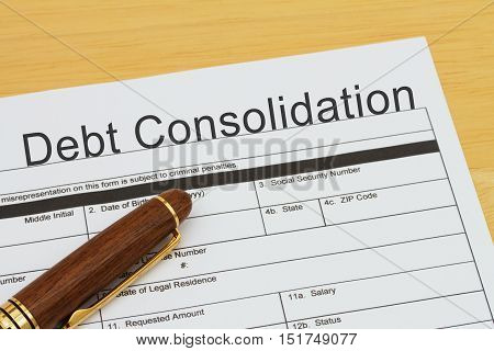 Applying for a Debt Consolidation Loan Debt Consolidation Loan application form with a pen on a desk
