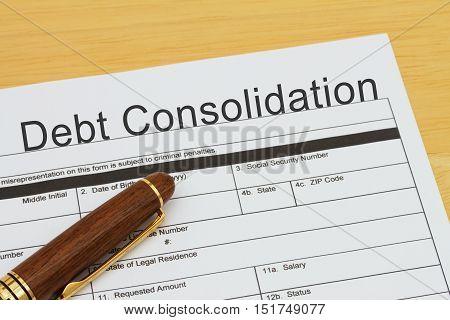 Applying for a Debt Consolidation Loan Debt Consolidation Loan application form with a pen on a desk