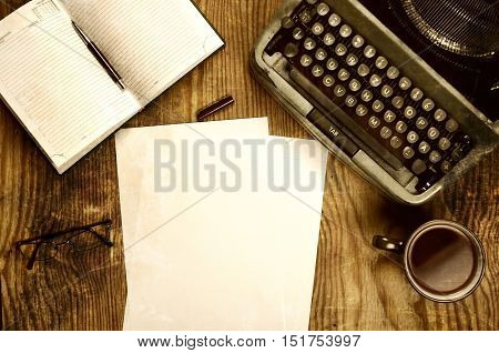 writer desktop with typewriter retro on a wooden table
