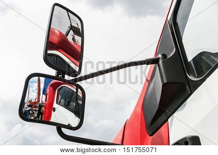 rear-view mirror on the truck. reflected in rearview mirror. focus on the bottom rear-view mirror