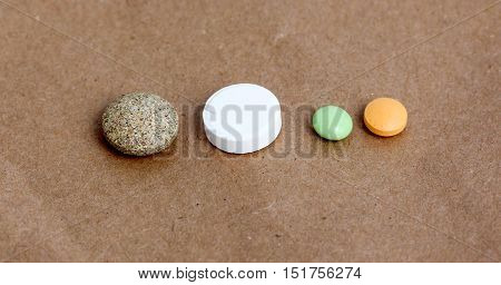 picture of a various pills tablettescapsules on whte background