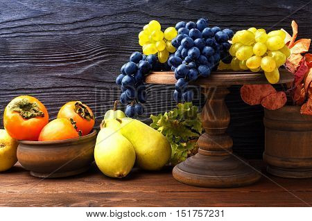 Still life with autumn fruits in a rustic style with copy space