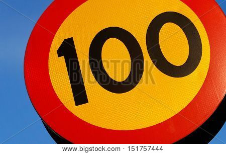 Close up of a speed limit 100 km(h sign