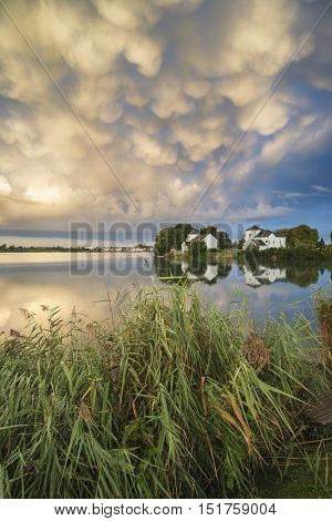Beautiful Mammatus Clouds Formation Over Lake Landscape Immediately Prior To Violent Storm