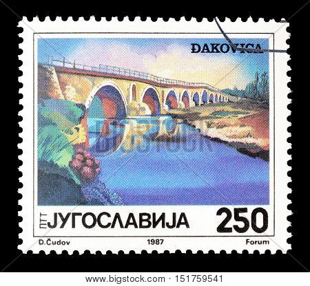 YUGOSLAVIA - CIRCA 1987 : Cancelled postage stamp printed by Yugoslavia, that shows Bridge in Djakovica.