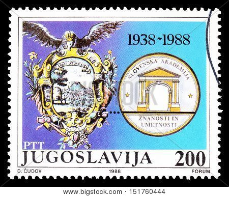YUGOSLAVIA - CIRCA 1988 : Cancelled postage stamp printed by Yugoslavia, that shows Emblem of Slovenian art and science association.