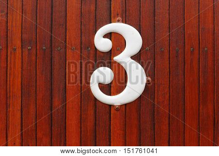 Number three on a vintage wood glad passenger coach indicates third class tickets needed.