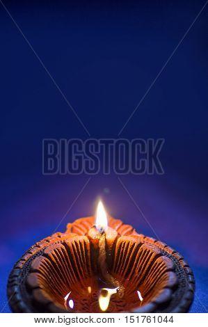 Traditional clay diya lamp lit during Diwali celebration
