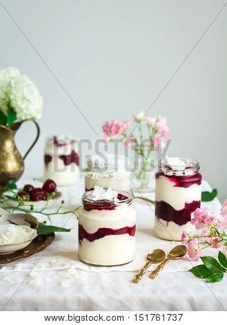 Mascarpone cherry trifle in a glass jar