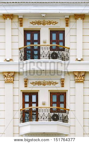 Close up of classic style building focus on balcony column baluster and window detail.