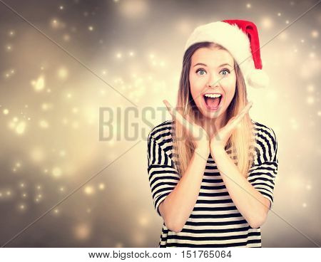 Surprised Young Woman With Santa Hat Posing