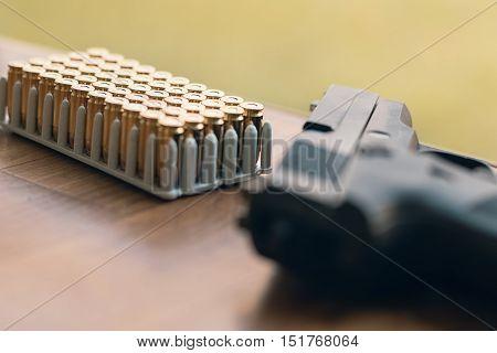 Gun With Bullets. Handgun Box With New Ammunition.