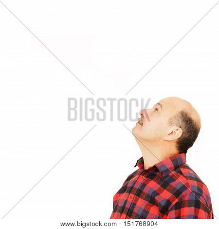 Bald man looking up and to the side. Looking at something or pay attention