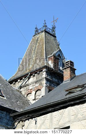 Old roof on a tower of an old woman batice from the Ardennes