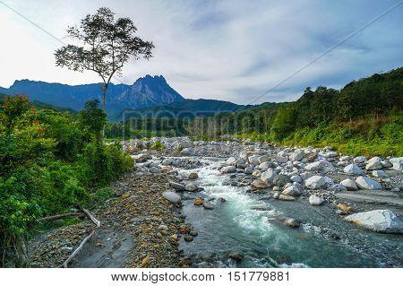 Magnificent mountain landscape river,forest and cloudy sky during sunrise at Melangkap village,Kota Belud,Sabah,Borneo.