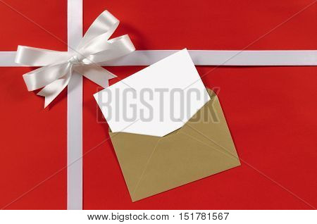 Christmas Or Birthday Card With Gift Ribbon And Bow In White Satin On Red Paper Background With Brow