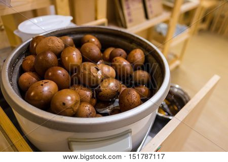 Tradional chinese herbal eggs in a big cooking pot for sale