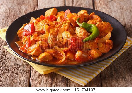 Indian Cuisine: Spicy Chicken Jalfrezi With Pepper And Onion Close-up. Horizontal