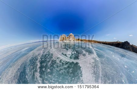 Aerial Panorama Shaman Rock Or Cape Burhan On Olkhon Island In Winter, Surrounded By The Blue Ice Of
