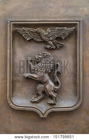 BELGOROD RUSSIA - OCTOBER 08 2016: Cast metal emblem of Belgorod city Russia. Heraldic shield (coat of arms) with an eagle and a lion.