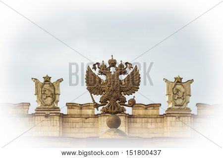 Coat of arms Russian Federation. Coat of arms on background of parapet administrative building government with USSR symbols. Photo with vignetting effect.