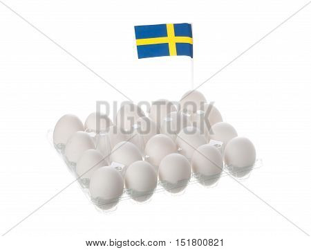 Twenty white Swedish hen eggs together with a Swedish flag in an egg carton isolated on white background.