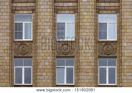 BELGOROD, RUSSIA - OCTOBER 08, 2016: Fragment of facade building administrative government Belgorod region with USSR symbols. Ornament of the Stalinist Empire style of architecture.