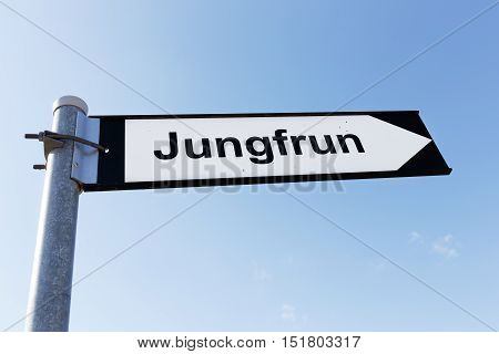 Signpost directing to the sea stack named Jungfrun (in English Virgin) in Lickerhamn on tre Swedish island Gotland.