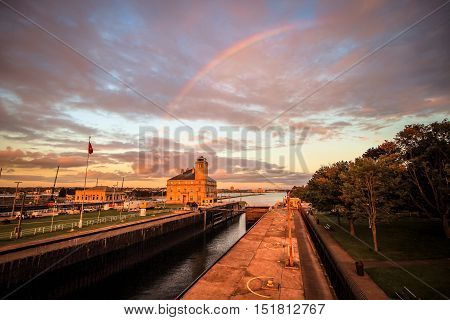 Sault Ste. Marie, Michigan, USA - September 18, 2016:  Rainbow over the landmark American Soo Locks in Upper Peninsula town of Sault Ste. Marie.