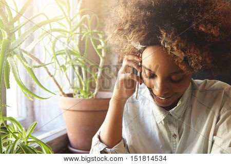People And Lifestyle Concept. Attractive Fashionable Dark-skinned Student Girl With Afro Hairstyle,