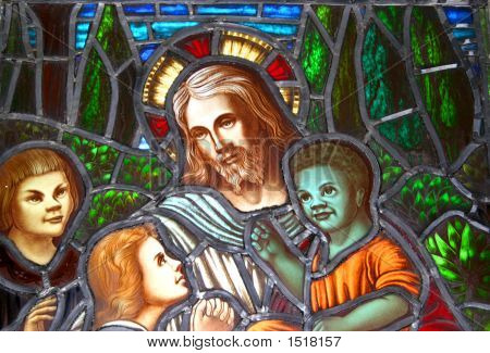A detail of a stained glass window circa 1899 showing Jesus surrounded by children of different ethnical backgrounds. poster