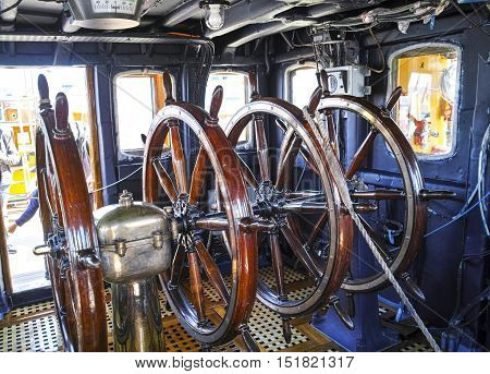 detail of old wood steering wheel in a tall ship