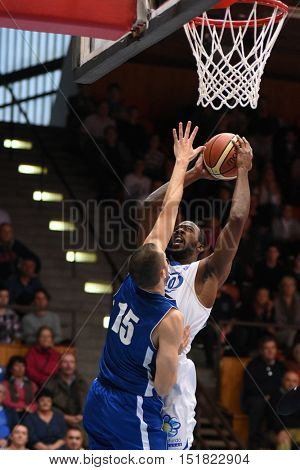 KAPOSVAR, HUNGARY - OCTOBER 6: Malik Cooke (in white) in action at Hungarian Championship basketball game with Kaposvar (white) vs. Sopron (blue) on October 6, 2016 in Kaposvar, Hungary.
