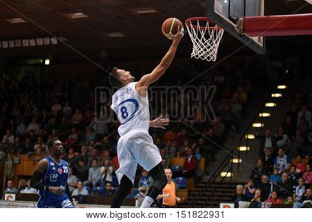 KAPOSVAR, HUNGARY - OCTOBER 6: Marton Fodor (white 8) in action at Hungarian Championship basketball game with Kaposvar (white) vs. Sopron (blue) on October 6, 2016 in Kaposvar, Hungary.
