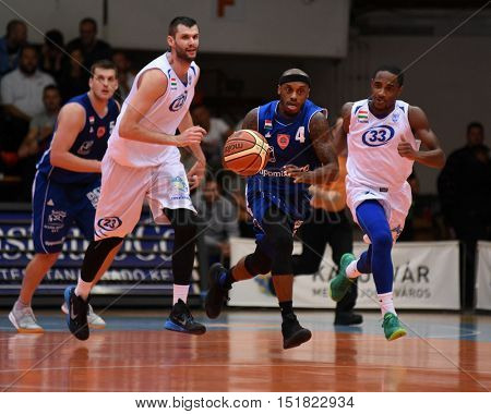 KAPOSVAR, HUNGARY - OCTOBER 6: Jay Threatt (in blue 4) in action at Hungarian Championship basketball game with Kaposvar (white) vs. Sopron (blue) on October 6, 2016 in Kaposvar, Hungary.
