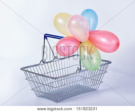 Concept Of Black Friday Advert Sale Empty Metal Shopping Basket With Colorful Balloons Set On Backgr