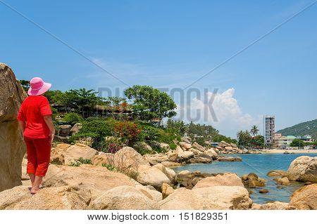 Woman tourist in the garden of stones Nui Hon Chong, Nha Trang, Vietnam