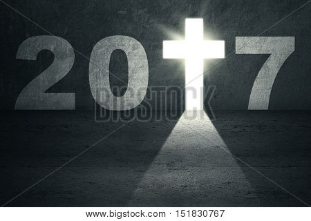 Concept of Happy New Year 2017. Image of number 2017 and a bright cross symbol shaped a doorway