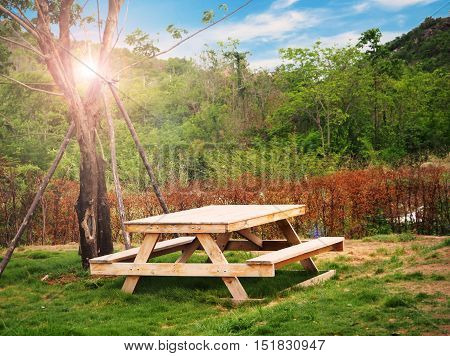 Wooden picnic table in the garden Thailand
