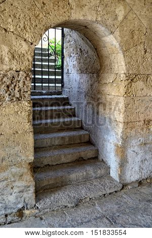a part of ancient sandstone wall with upstairs exit