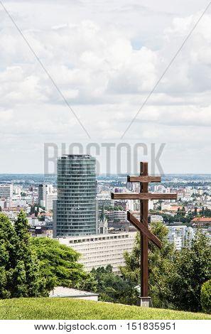 Big christian cross in Slavin and cityscape of Bratislava the capital of Slovak republic. Religious object. Architectural theme.