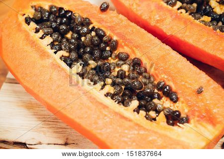 Closed up fresh papaya fruit in kitchen